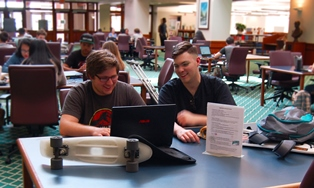 Two students working on their laptops